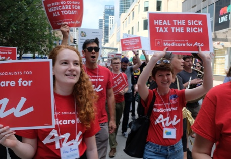 Democratic Socialists marching to demand Medicare for All